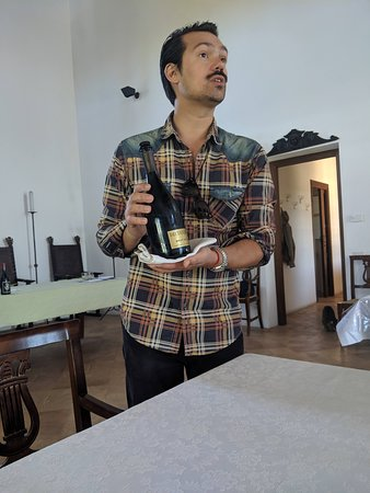 Pablo serving us wine during our meal