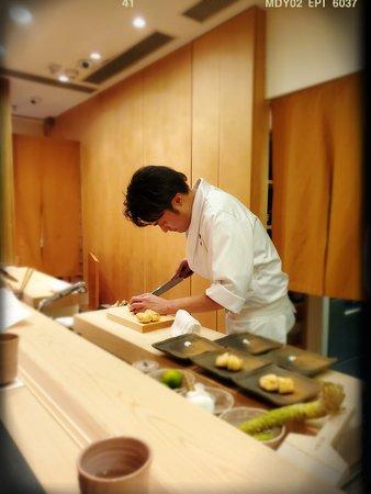 Chef Suzuki cutting the fried beancurd
