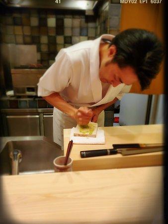 Chef Suzuki grinding the wasabi