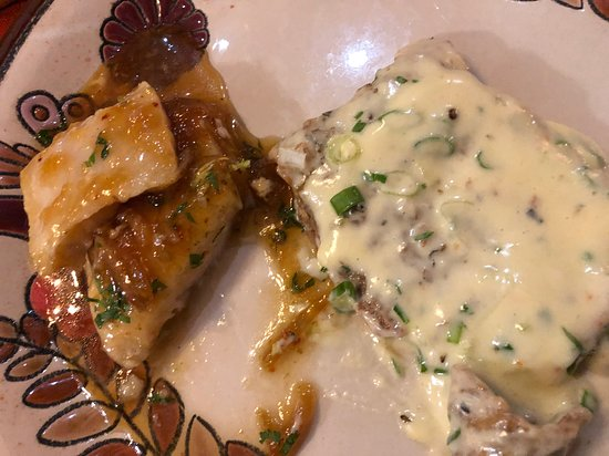 Fish (on the left) and eggplant with blue cheese sauce (on the right)