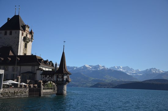 Oberhofern Castle by Lake Thun with the Bernese Alps in the background