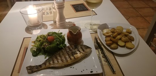 Nice grilled trout, well prepared with Lemon sauce on the side Yumm