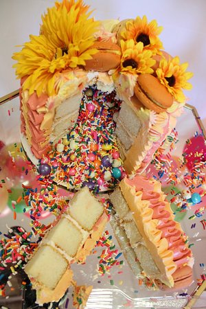 Pinata cake! one of our most popular style cakes with surprise candy and sprinkles inside!