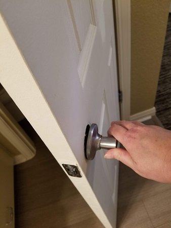 """Bathroom door handle (not safe to close) in """"master"""" bedroom"""