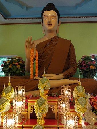 The main statute of Lord Buddha giving his blessings in the main hall at Wat Tha Ka Rong