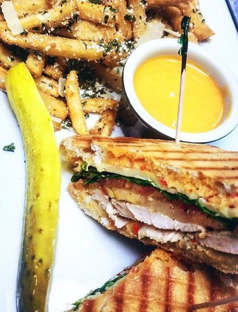Chicken & Spinach Panini grilled then pressed between Cibatta with Roasted red pepper Aioli, tomatoes and smoked gouda cheese. This customer chose our truffle parmesan fries as side