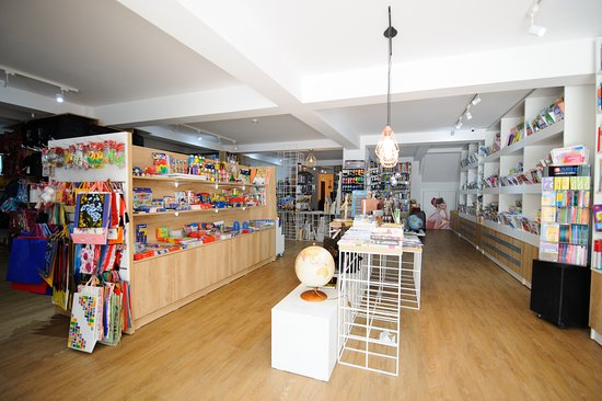 Novelties section at the shop entrance. Bestsellers, new prints, Craiova related books or almanacs on various subjects.