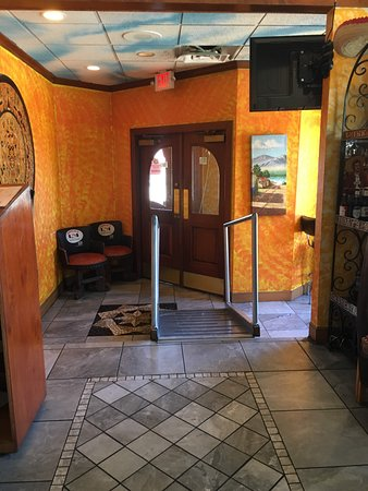 The entry area of the restaurant with the ramp to access the dining area of the restaurant.