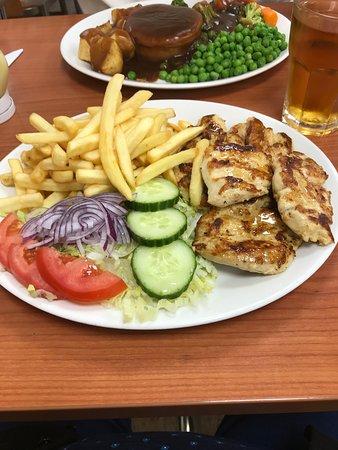 Marinated chicken, side salad & chips