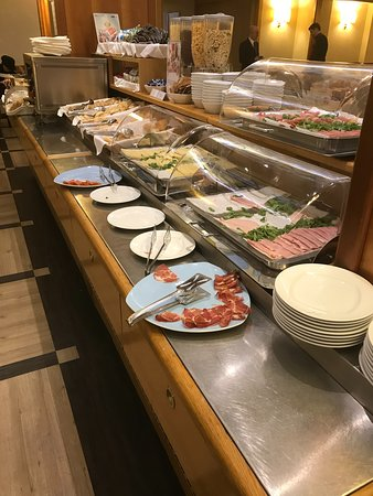 Great variety of cold meats, dry cereal, bread/buns at the breakfast buffet.
