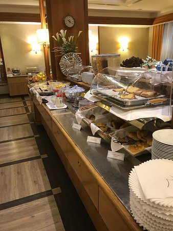 Pastries and cold cereals at the breakfast buffet.