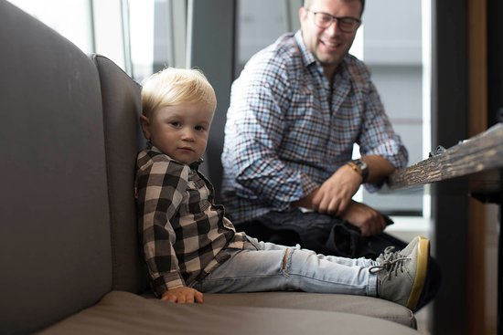 This little fella came with his own booster seat but he still enjoyed the comfy couch with dad.