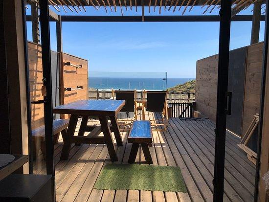 Boca Pupuya, Chile: Terraza con vista al mar de las cabañas de 25 Nudos Lodge
