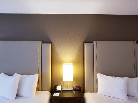 Travelodge by Wyndham Fort Wayne in 2 Queen size bed guest rooms including Fridge, microwaves, Coffee maker, Iron,Iron Board, Valet Laundry Service