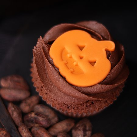 The ghost of Boo Cupcake wanders around the bakery waiting for Halloween!