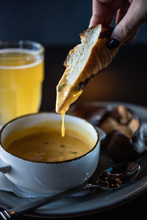 Hot beer cheese with soft pretzels