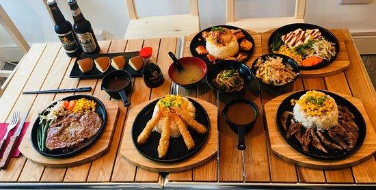 A selection of our popular dishes: King Prawn Katsu Curry, Beef Pepper Rice, Spicy Kimchi Chicken, 8oz Ribeye Steak, Tofu Teriyaki and Custard Dorayaki.