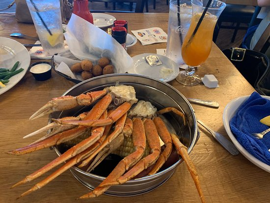 Really nice facility but we come here for the food. I always get the Original Crazy Crab boil which is DEFINITELY the largest snow crab legs I've had. So flavorful and satisfying! I mean, I am tempted by other delicious things on the menu but I can't help myself...snow crab all the way. And then the perfect key lime pie. Dense and tart, not creamy, with the best graham cracker crust and whipped cream. Heaven. Bonus: the outdoor sports bar/eating area is pet friendly. 🧡 LOVE IT. Go.