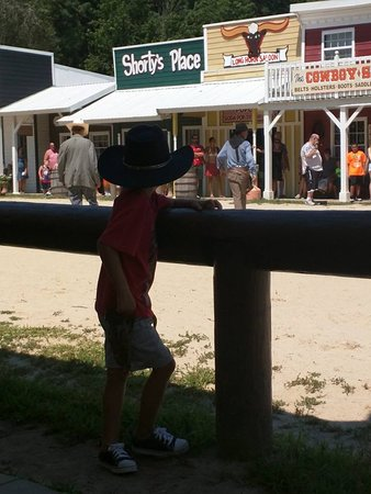 """Frontier Town: Son watching the shooting at the """"OK Corral"""". """