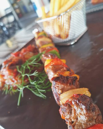 """Beef skewer served with french fries and french""""ratatouille"""""""