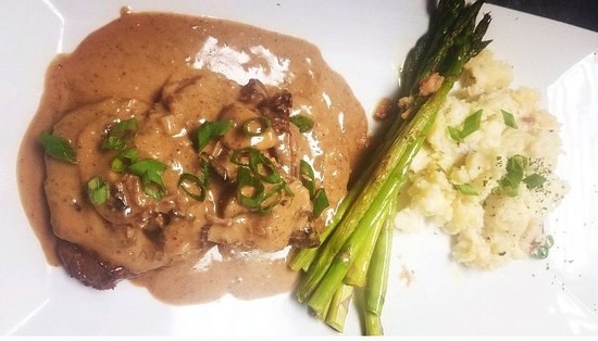 Steak Diane - 3 Filet mignon medallions in a Cognac cream demi glace with a hint of Dijon served with asparagus and roasted garlic red smashed!