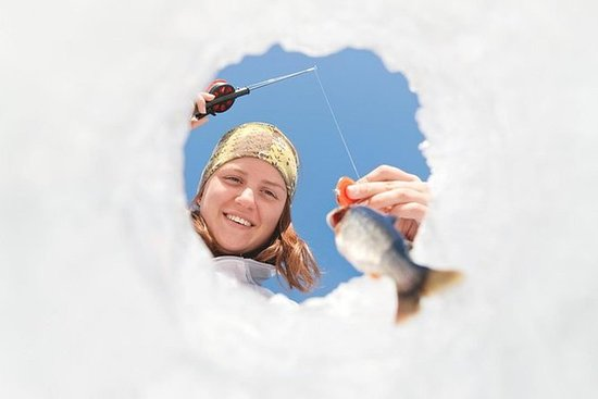 Ice fishing by snowmobile from Levi
