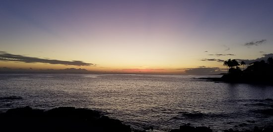 Ocean view just after sunset from just below hotel grounds (across street above rocky beach)