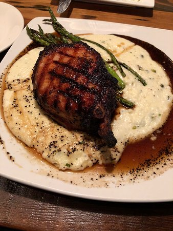 The Broken Bit Steakhouse: 16oz pork chop with whiskey grits! Great!