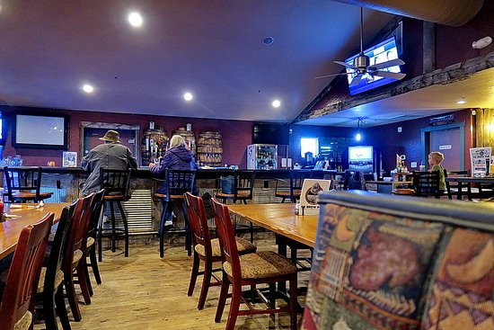 Severance, CO: G5 Pub's table and bar area