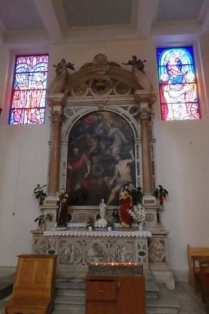 St Dominic Church: A few stained glass windows and one of the side altars