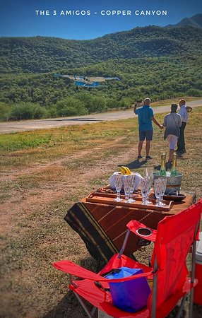The 3 Amigos : Clients flying into Batopilas with champagne tray waiting for them.