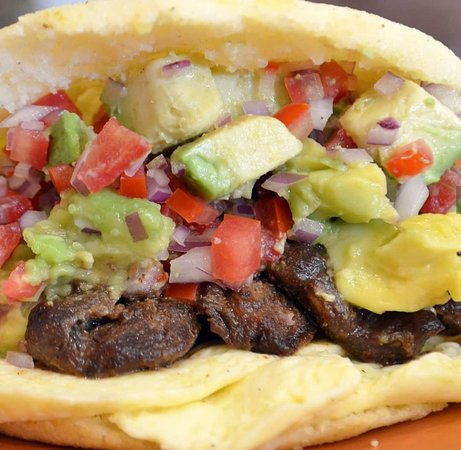 The cheff recommends the Arepa Llanera, Perfectly marinated skirt steak, Venezuelan cheese, avocado and topped with Pico de gallo !!