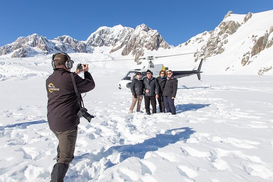 Franz Josef, New Zealand: 1, 2,3 and everybody smile. Time for a photo with HeliServices.NZ Pilot Dion capturing the perfect shot
