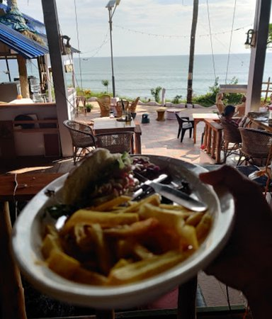 Nomad chef special Burger.  Best coffee in varkala . Lemon ice tea and punjabi bowl Ajith special meat naan
