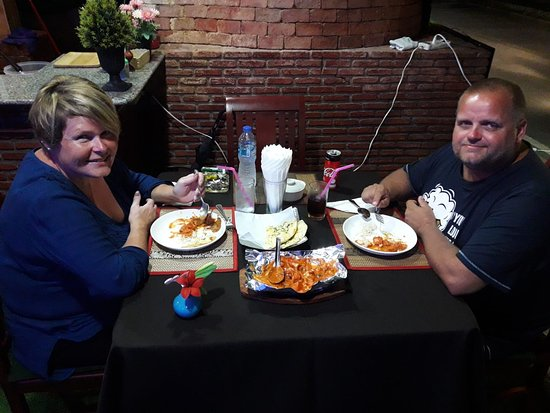 Highway Curry lovely customer enjoying Highway Curry Special Chicken Tawa with Naan