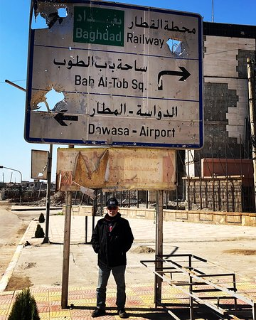 Photo taken in Old Mosul underneath beaten up Railway sign.