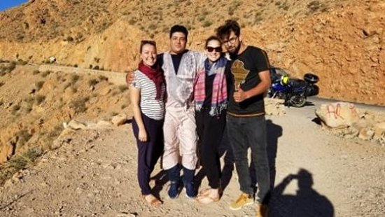 Desert Majesty: From left to right : Myself, Hassan our driver, My friend Rebecca and Ismail the nicest guide!
