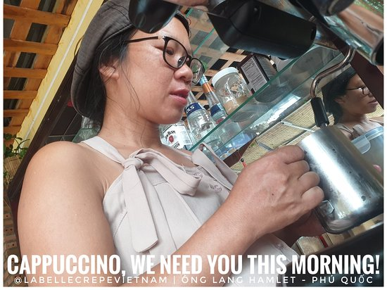 """Caption: Thuong, our coffee expert, is making us a much needed #cappuccino this morning.  Our team is working 12h a day, 7/7 and the coffee """"fuel"""" is essential for us to """"wake up""""...  Do you need a coffee to start the day?  If yes, come to see us!  Where: La Belle Crêpe at the crossroad to @mangobayphuquoc Phú Quốc, Vietnam.  If you are near Ông Lang Beach, come and try some of the best Brittany crepes you'll ever eat! Our team welcomes you! We're open from 9h till 21h."""