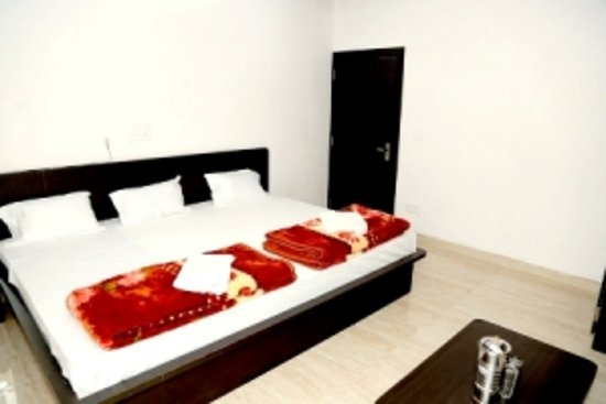Udaipur District, Indie: It is a family luxury room with all basic amenities.