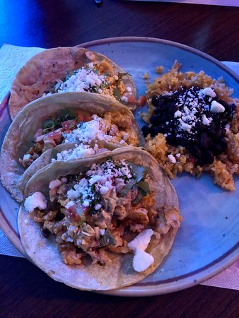 Watertown, WI: Tilapia tacos with corn tortilla and a side of rice and beans.
