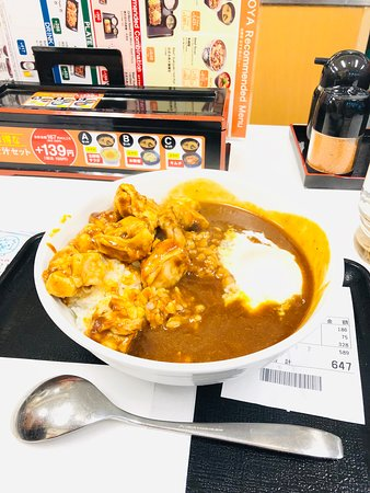 Spicy chicken curry with soft-boiled egg