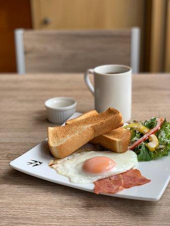 toast, egg, bacon, salad and coffee breakfast