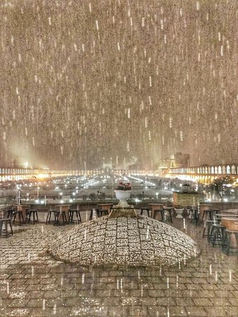 First snowy night in Isfahan, on top of Qeysariyeh Museum and Cafe Gallery. A pleasure experience