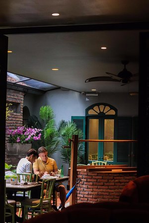 Lady Coco - Unwind whilst having chit chat at our garden themed dining area.