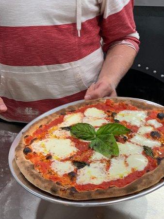 Margherita Pizza, thin crust, authentic Sicilian, hand made in a brick oven pizza