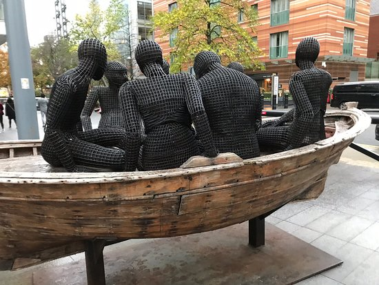Wooden Boat with Seven People Sculpture