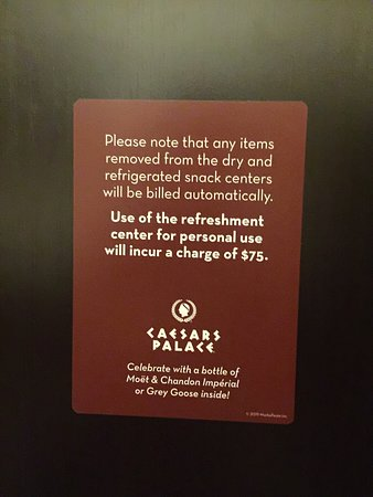 Sign on the door of the fridge.