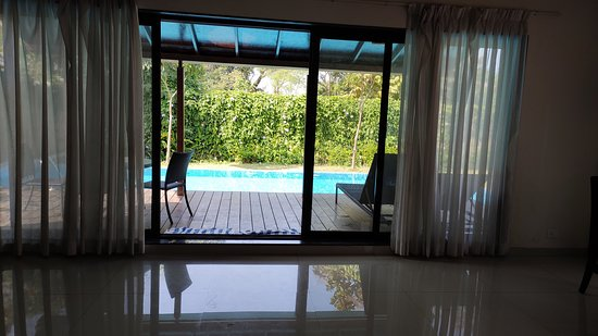 Villa living room with patio and private pool
