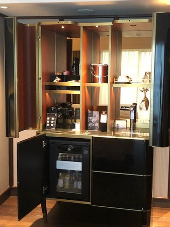 Opening the doors revealed the refrigerator, capsule coffee machine, water dispenser and our complimentary supply of coffee and tea.