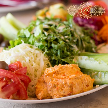 Colorful salad, lot of vitamins, balanced meal and satisfied guests.